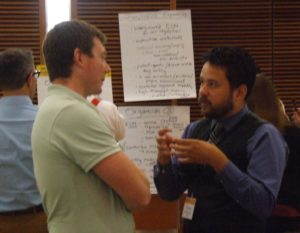 Carlos discussion BME concepts with another conference guest.