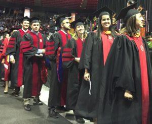 Gavin and Maria walking at Graduation!