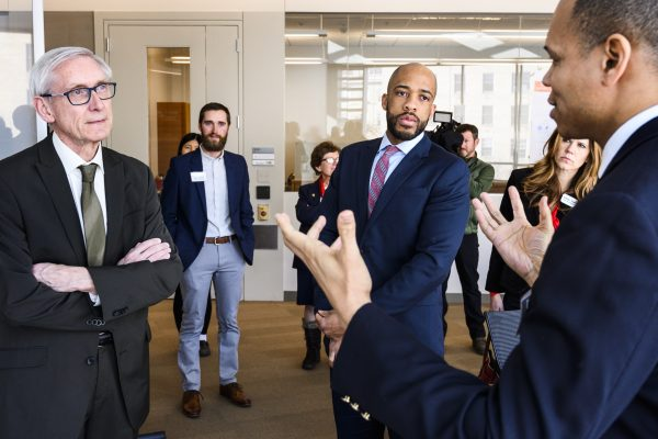 Left to right, Wisconsin Gov. Tony Evers and Lt. Gov. Mandela Barnes listen to Dr. Randolph Ashton describe data science research at the Wisconsin Institute for Discovery during a Evers's tour of the Discovery Building at the University of Wisconsin-Madison on March 5, 2019. (Photo by Jeff Miller / UW-Madison)